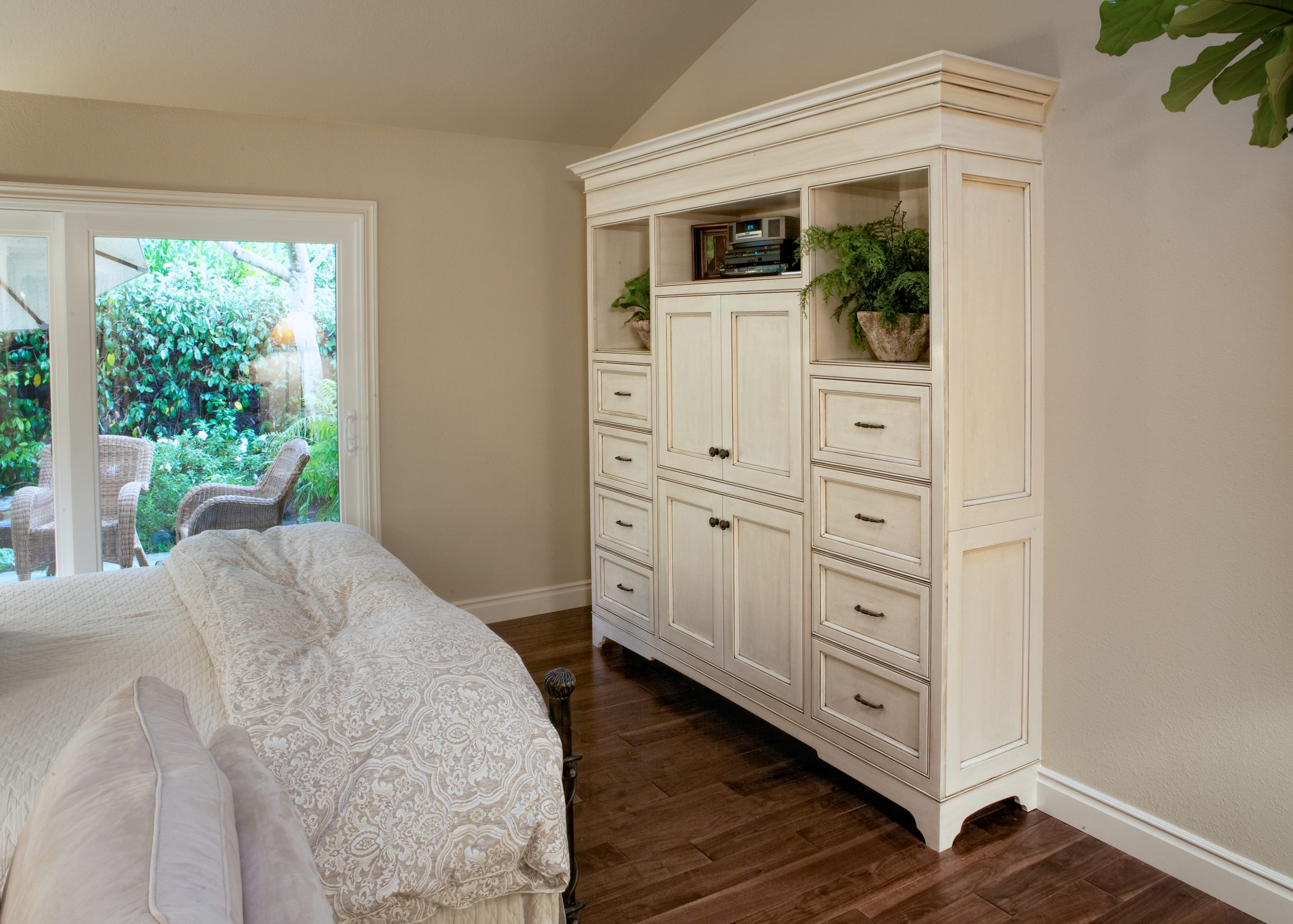 Custom bedroom entertainment center in luxury home