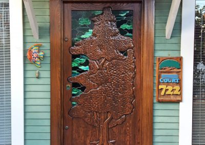 Repair and refinish handcrafted door on beach cottage