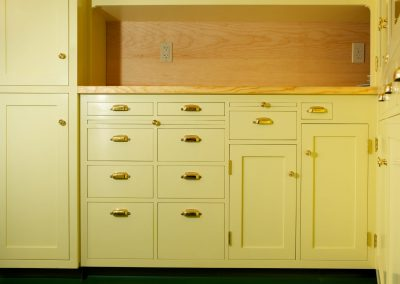 Brass pulls on yellow cabinets