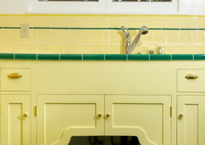 Sink cabinet in historic yellow kitchen